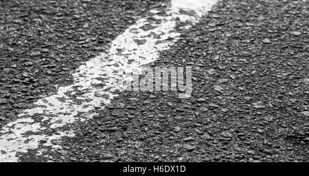 White dividing line on tarmac, highway road marking. Abstract transportation background - Stock Photo
