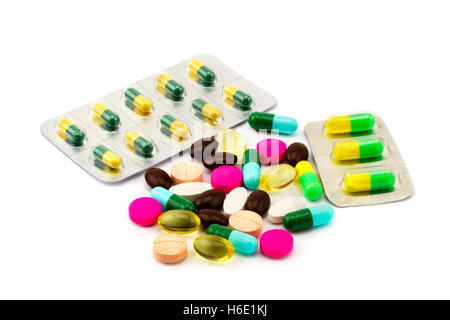 Pile of different pills and capsule of medicine on white background - Stock Photo