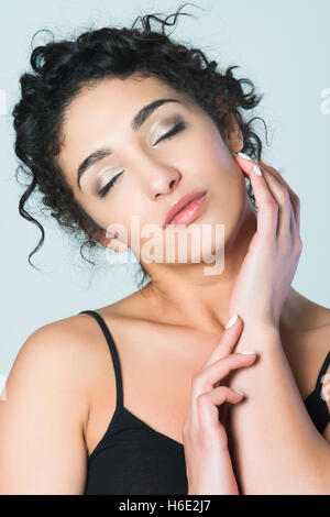 Beautiful young woman hand feeling skin - Stock Photo