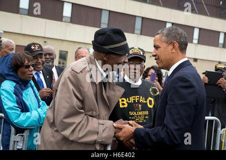 U.S. President Barack Obama greets Army veteran and Buffalo Soldier Sanders H. Matthews at the Stewart Air National - Stock Photo