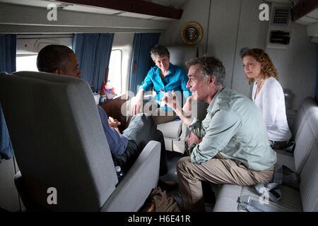 U.S. President Barack Obama talks to Interior Secretary Sally Jewell, Congresswoman Debbie Wasserman Schultz, and Bill Nye the Science Guy aboard Marine One en route to Miami International Airport April 22, 2015 in Miami, Florida.