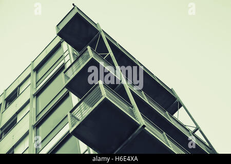 Abstract contemporary architecture fragment, walls and balconies made of glass and concrete. Green tonal correction - Stock Photo
