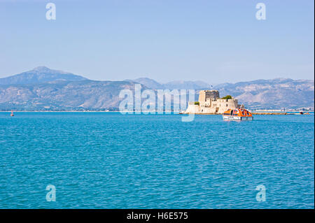 The Bourtzi Castle (Tower) is located in the middle of the harbour of Nafplio, Argolida, Greece. - Stock Photo