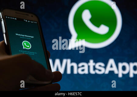 A smartphone display shows WhatsApp Messenger application - Stock Photo