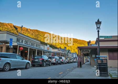 Arrowtown, New Zealand - February 2016: Old classic buildings and shops on Buckingham Street in the historic town - Stock Photo