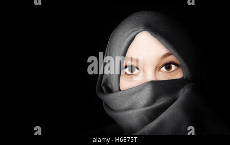 Portrait of young, friendly muslim woman - Stock Photo