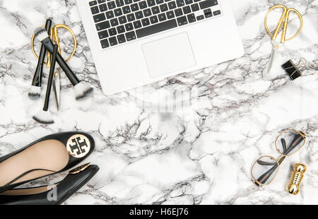 Notebook supplies feminine accessories on marble office desk