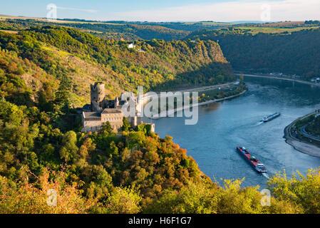 Burg Katz castle with Loreley in background, Rhine valley autumn - Stock Photo