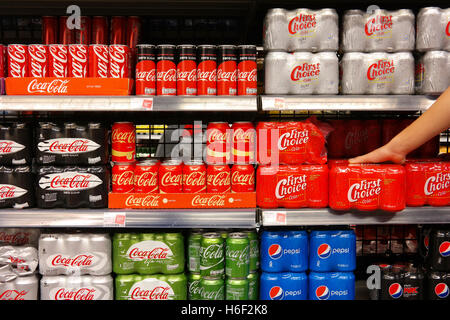 Various Brands of Cola in a Store - Stock Photo
