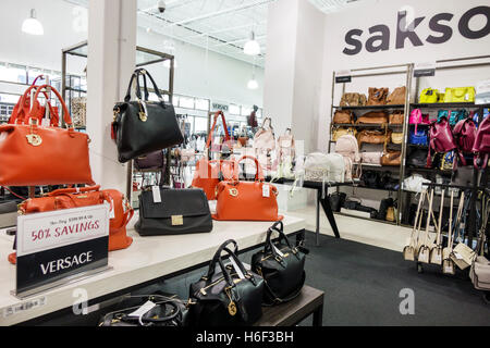 Palm Beach Florida Outlets shopping Saks Fifth Avenue Off 5th inside display sale Versace designer handbags - Stock Photo