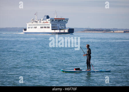Paddleboarders enjoying the sunny weather and calm seas in The Solent off the coast of Southsea, Portsmouth in the - Stock Photo