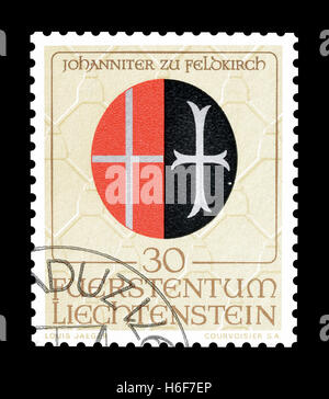 Cancelled postage stamp printed by Liechtenstein, that shows Coat of arms. - Stock Photo
