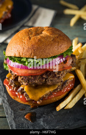 Homemade Cheese Smash Burger with Lettuce Tomato and Fries - Stock Photo