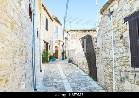 The old village consists of the narrow streets with the stone houses and high stone fences, Kato Drys, Cyprus. - Stock Photo
