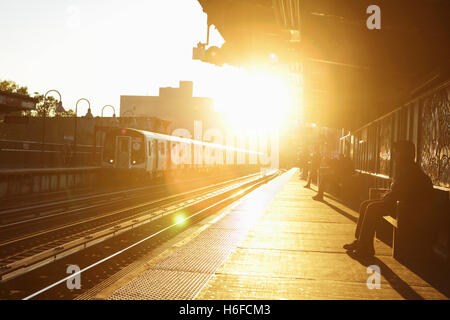 Morning sunrise at the Marcy Avenue subway station in Brooklyn, New York - Stock Photo
