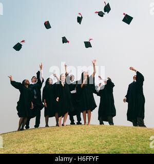 Successful Masters PHD Graduation College Concept - Stock Photo