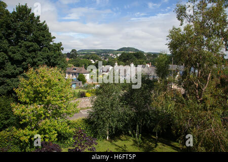 Looking west across houses in Sidmouth to an area of green belt on the side of the Sid Valley at Sidmouth, Devon, - Stock Photo