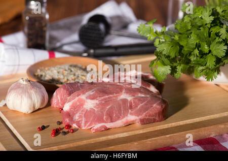Pork steak on a cutting board - Stock Photo