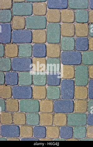 Cobblestone texture background closeup, green, yellow, blue, tan, grey, gray, beige ashlar, detailed textured vertical - Stock Photo