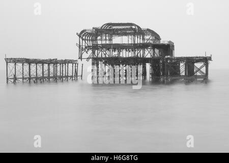 Black and white photograph of the remains of the west pier in Brighton Sussex United Kingdom - Stock Photo