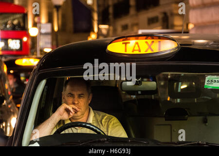 Taxi drivers in London's West End - Stock Photo
