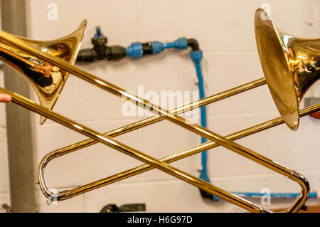 Close-up details of musical instruments being played. - Stock Photo
