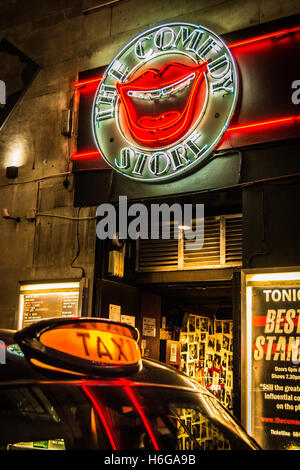 London taxi cab sign outside the Comedy Store in Soho, Central London, UK - Stock Photo