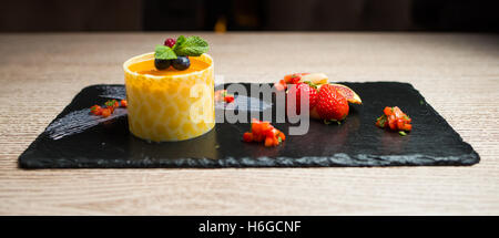 milfeyt in glaze with fruit on the board - Stock Photo