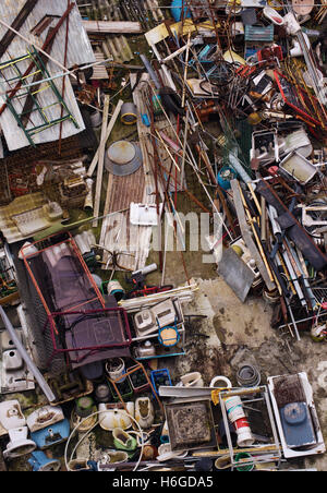 Top view of a junkyard with a chaotic load of wasted trash - Stock Photo