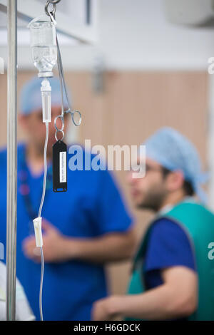 Two Anaesthetists in discussion during an operation in a hospital theatre - Stock Photo