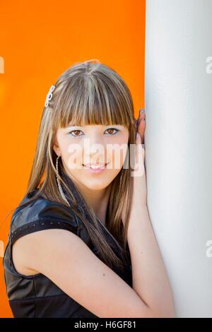 Teen teenager girl portrait looking at camera eyescontact eyes-contact face humble modest - Stock Photo