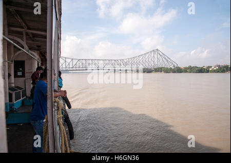ferry boat transport on Hooghly River  Howrah  Bridge Kolkata West Bengal India - Stock Photo