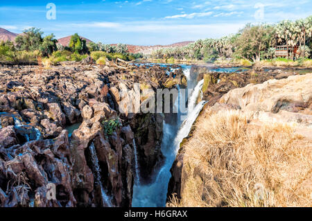 View of Epupa falls on the border of Namibia and Angola. The falls are created by the Kunene River in the Kaokoland - Stock Photo
