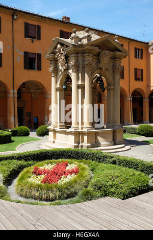 The wishing well, within the courtyard of the Palazzo d'Accursio, home to the Municipal Art Collection of Bologna, - Stock Photo