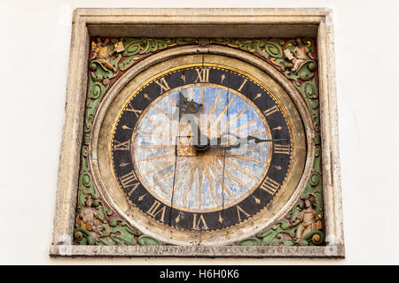 Clock on exterior wall of Church of the Holy Ghost, Old Town, Tallinn, Estonia - Stock Photo