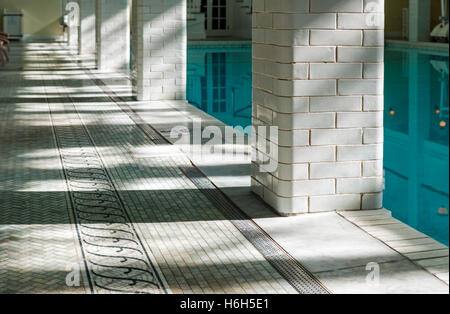 Abstract view of sun & shadows on tile surrounding interior spring-fed swimming pool; Omni Bedford Springs Resort - Stock Photo