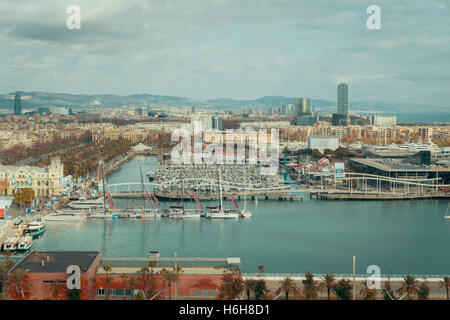 Wide view from high point of city, bay, harbor in Barcelona, Spain, cloudy day, vintage colour - Stock Photo
