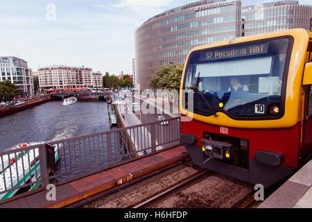 BERLIN - JUNE 18: S7 S-bahn train docking on the platform of Friedrichstrasse station on June 18, 2012 in Berlin, - Stock Photo