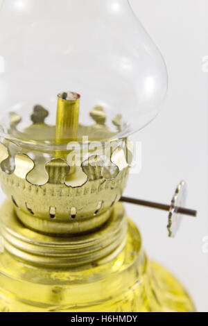 Classic kerosene lamp with convex chimney glass. Commonly use in the past before electricity was invented. - Stock Photo