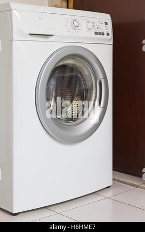 White Front Load Washing Machine With Glass Door Open Stock Photo