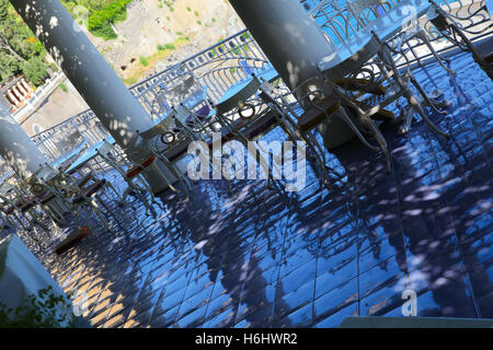 Hotel balcony over looking the sea high on the cliffs shaded pillars wrought iron ornamental safety fences victorian - Stock Photo