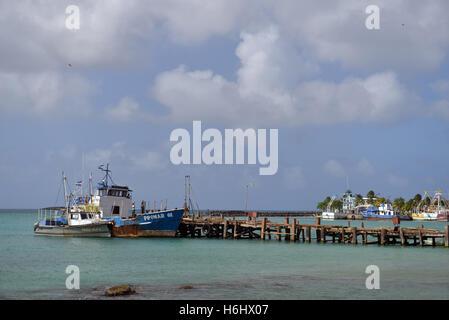 BIG CORN ISLAND, NICARAGUA-JAN. 13: A commercial fishing boat is seen in harbor of Brig Bay in Big Corn Island, - Stock Photo