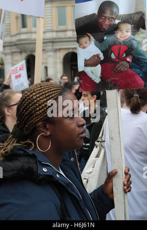 London , UK 29 October 2016 Protesters carrying banners and placards chant as they march down Whitehall during a - Stock Photo