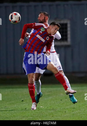 Budapest, Hungary. 29th October, 2016. Mate Vida (R) of Vasas FC battles for the ball in the air with Attila Fiola - Stock Photo
