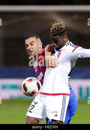 Budapest, Hungary. 29th October, 2016. Mahir Saglik (L) of Vasas FC fights for the ball with Stopira #22 of Videoton - Stock Photo