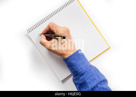 man's hand writing with a fountain pen. isolated - Stock Photo