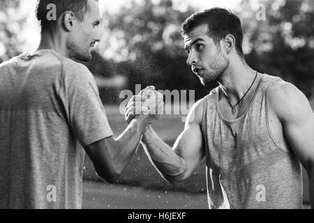 Black and white portrait of handsome men with arm wrestling - Stock Photo