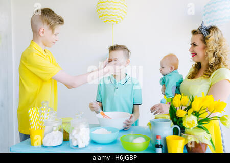 The family makes baking in the kitchen - Stock Photo