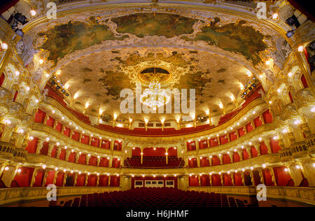 Prague State Opera House wide baroque interior auditorium viewed from the stage Prague Czech Republic - Stock Photo