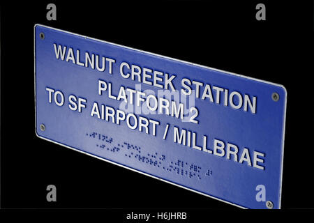 Metal plaque sign on Walnut Creek 'Bart' station with platform information duplicated in Braille for visually impaired - Stock Photo